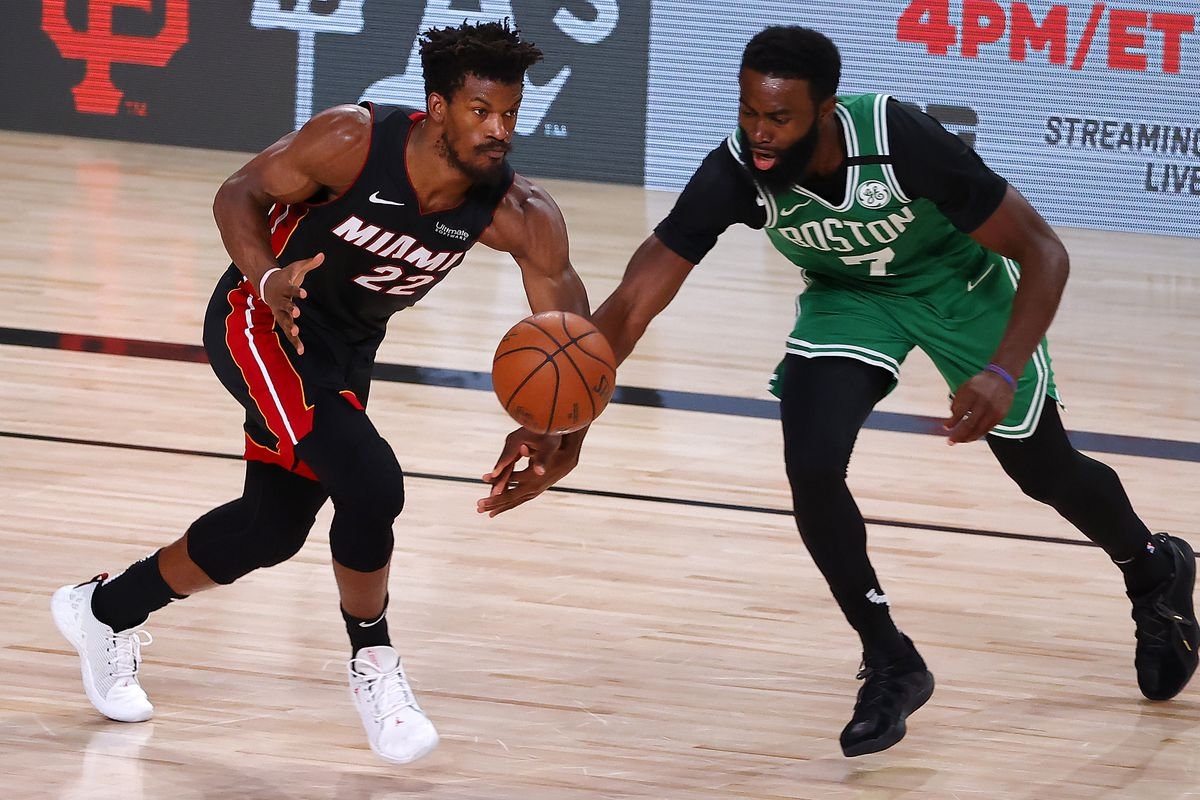Jimmy Butler of the Miami Heat and Jaylen Brown of the Boston Celtics fight for a loose ball during the second quarter in Game Three of the Eastern Conference Finals during the 2020 NBA Playoffs at AdventHealth Arena at the ESPN Wide World Of Sports Complex on September 19, 2020 in Lake Buena Vista, Florida.