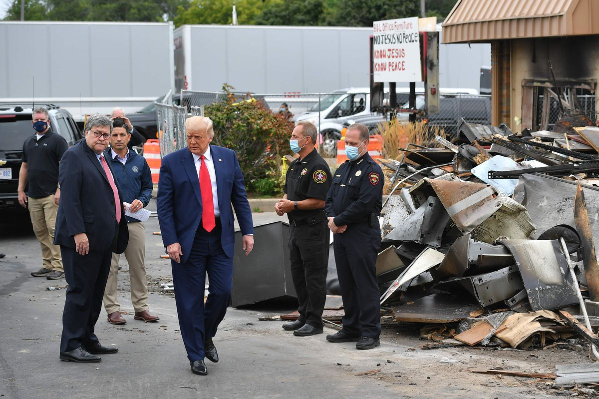 President Donald Trump, center, with Attorney General William Barr, second from left, and Acting Homeland Security Secretary Chad Wolf, third from left, during a tour of an area affected by civil unrest in Kenosha, Wisconsin