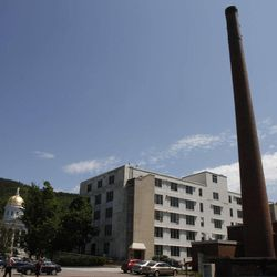 FILE - In this June 7, 2011 file photo, the smoke stack for the state-owned biomass heating plant stands in Montpelier, Vt. After a hiccup, the city of Montpelier has decided to go ahead with starting construction of Vermont's first downtown district heating project. Supporters cite likely long-term cost savings and carbon reductions by switching from oil. Detractors say the benefits are exaggerated, and there's too much uncertainty about up-front costs.