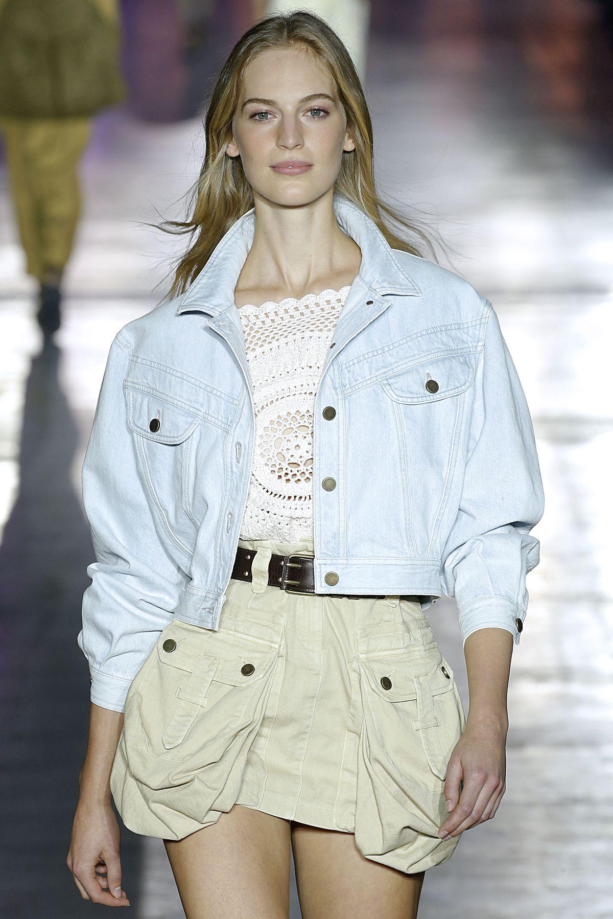 A model walks the runway wearing a miniskirt with mondo pockets.