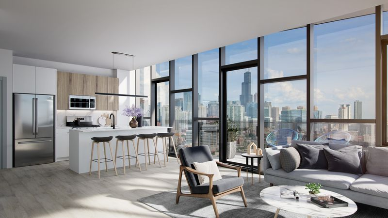 A rendering of an apartment unit with a glass wall overlooking the city. There's a white and wood kitchen and a sitting area with a gray sofa, chair, and coffee table.