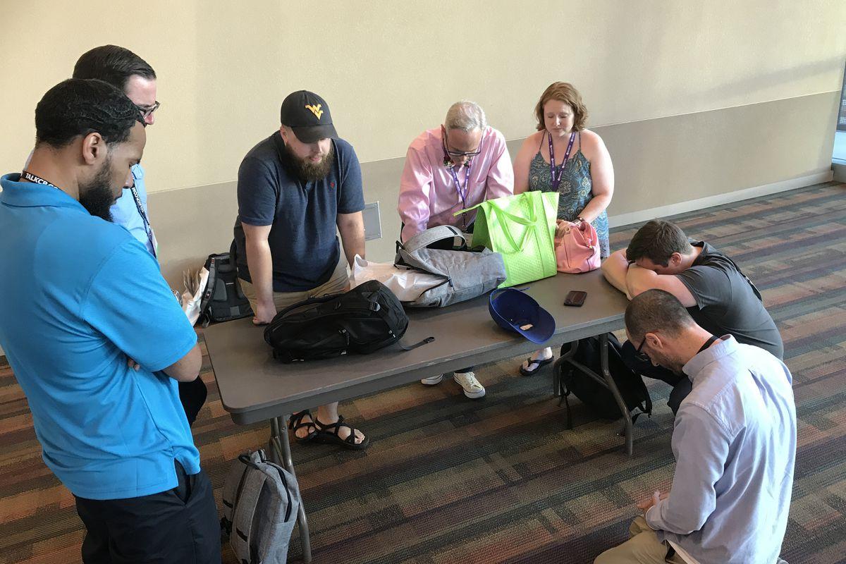 A group of concerned pastors deliberates and prays over the alt-right resolution at SBC 2017