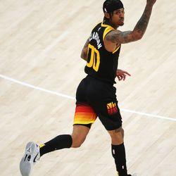 Utah Jazz guard Jordan Clarkson (00) create a 3-pointer during the NBA playoffs in Salt Lake City on Thursday, June 10, 2021. The Jazz won 117-111.