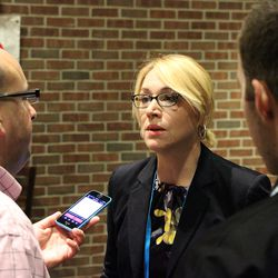 ESPN's Doris Burke listens to The Day's Mike DiMauro.