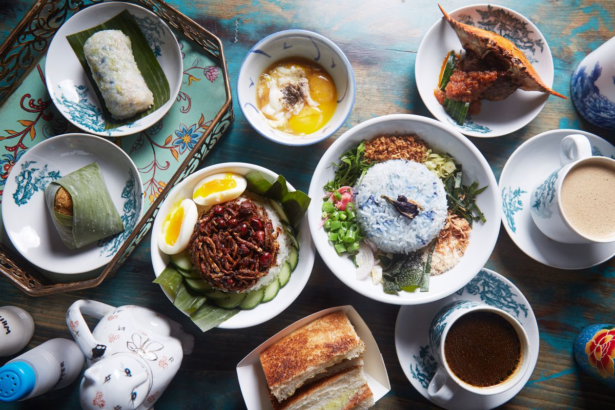 Several dishes take up a tabletop at Kopitiam in New York City