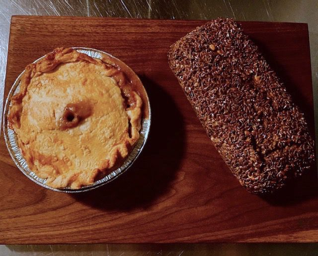 Beef pot pie in a tin can, next to rye bread