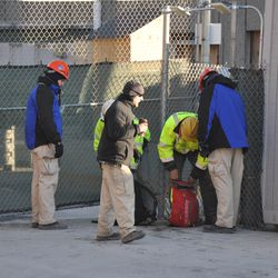 Workers having their bags inspected while checking out at Gate K on Waveland