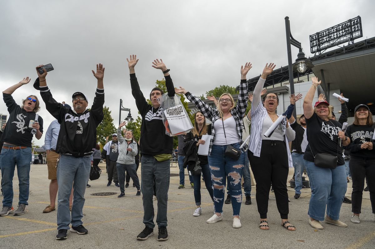 Chicago White Sox fans cheer as Sox staff throw T-shirts at them during the Change the Game Rally in the parking lot at Guaranteed Rate Field on Monday, Oct. 4, 2021.