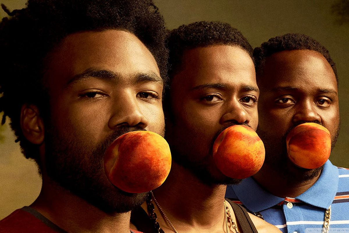 Donald Glover, Keith Stanfield, and Brian Tyree-Henry with peaches in their mouths