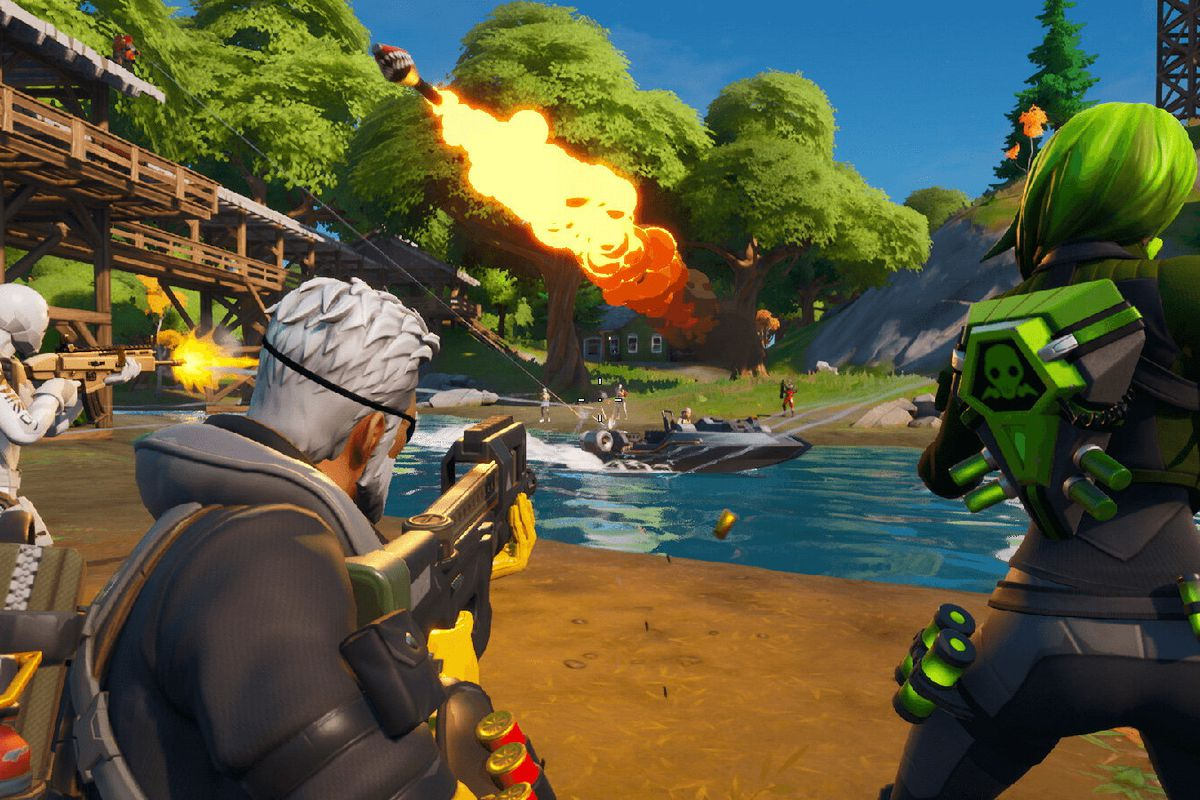 Fortnite - three players fire across a river at enemies