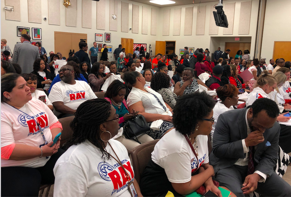 """Supporters of interim superintendent Joris Ray wore """"Stay with Ray"""" T-shirts including the district's logo Tuesday."""