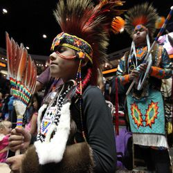 Native American and indigenous dancers prepare for the grand entry during the 29th Annual Gathering of Nations in Albuquerque, N.M., on Friday, April 27, 2012. The event draws more than 3,000 dancers and singers and tens of thousands of spectators for three days of competitions and the crowning of Miss Indian World.