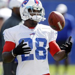 Buffalo Bills' C. J. Spiller tosses a ball while waiting for a drill during NFL football practice in Orchard Park, N.Y., Wednesday, Sept. 19, 2012. Spiller has the Buffalo Bills offense up and running, and coach Chan Gailey couldn't be more pleased.