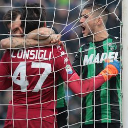 Andrea Consigli of US Sassuolo Calcio (C) celebrates after save a penalty kick with his teammate Francesco Acerbi (L) and Diego Falcinelli (R) during the serie A match between US Sassuolo and FC Internazionale at Mapei Stadium - Citta' del Tricolore on December 23, 2017 in Reggio nell'Emilia, Italy.