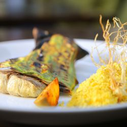 Pirarucufishcooked inbanana leafwith<strong></strong><em>farofa</em> made from herb stems and manioc flour