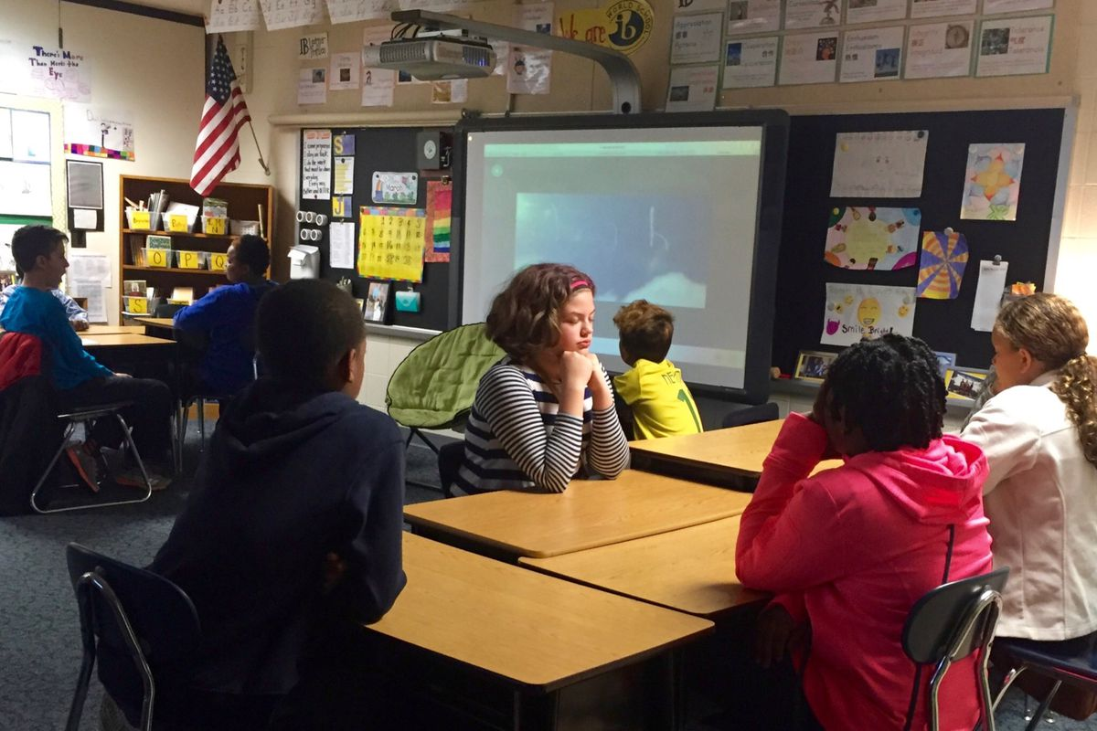 A table of students in Deanna Nibarger's fifth grade class at Crooked Creek Elementary School participates in an attention exercise centered around gratitude.