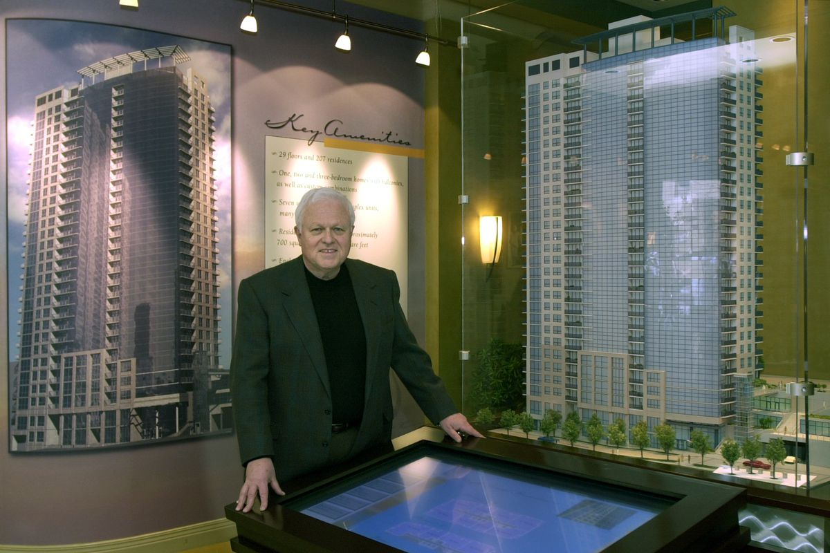 Architect Jim Loewenberg in 2003 with models of one of his buildings at 1 W. Superior St.
