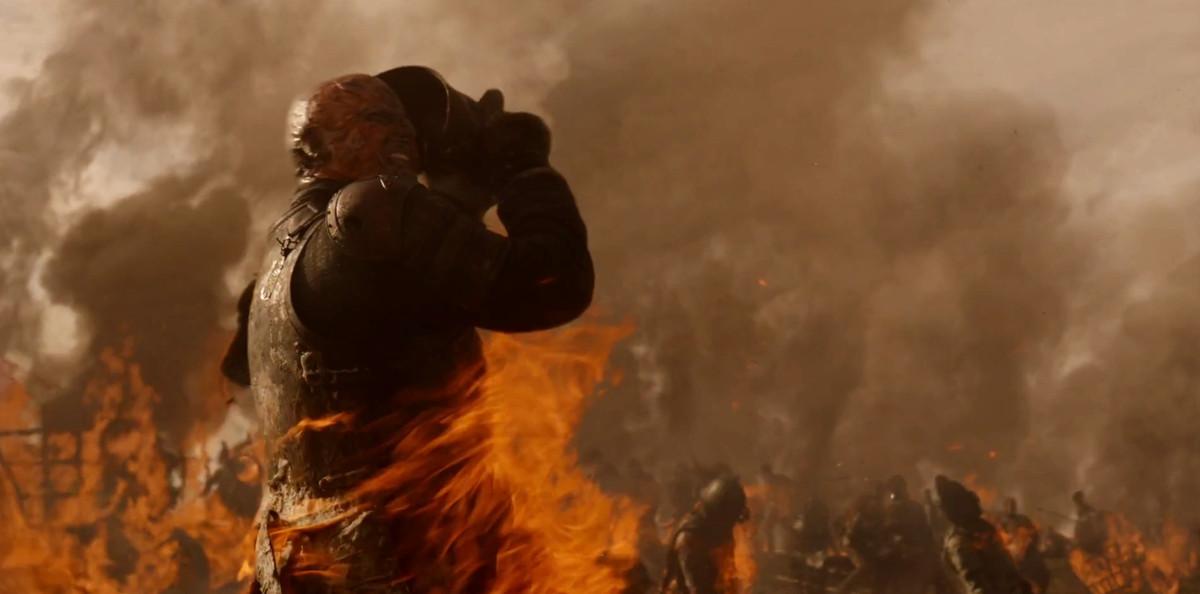 Screenshot of a bald man burning