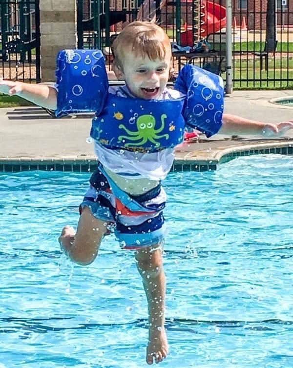 Judah Brown leaps into the water wearing a flotation vest. His mother Christi Brown says the device gave him a false sense of confidence and taught poor body positioning, which she believes put him at greater risk. He was 3 when he drowned, having gone in the water not wearing it.
