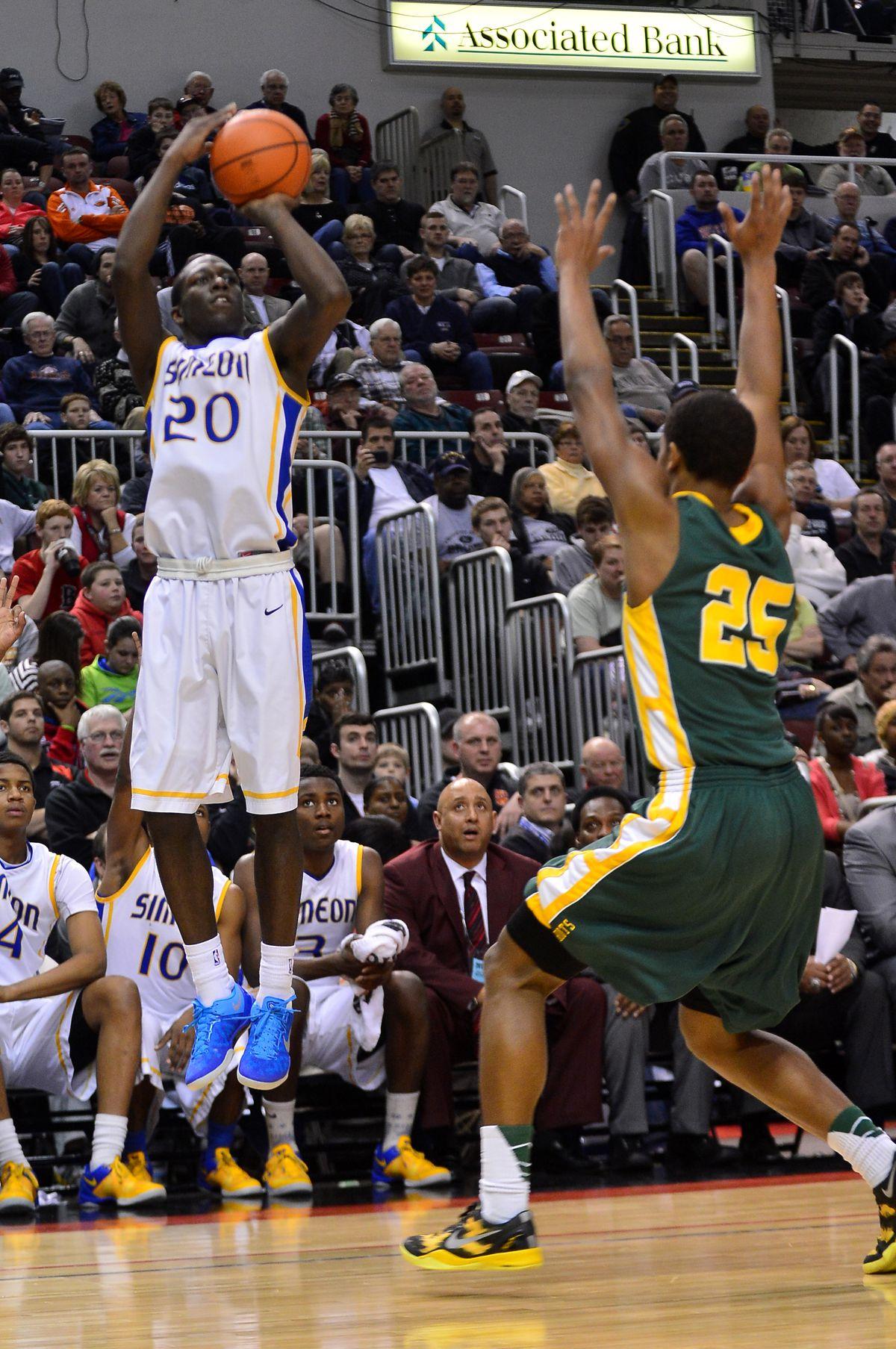 Simeon's Kendrick Nunn shoots a three over Stevenson's Cameron Green.