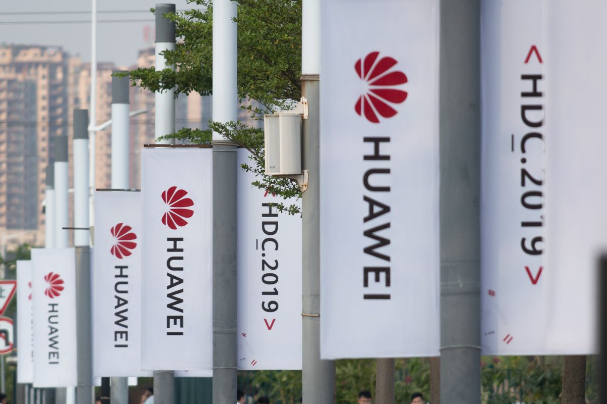 Banners with the Huawei logo are seen outside the venue for its 2019 developers conference.
