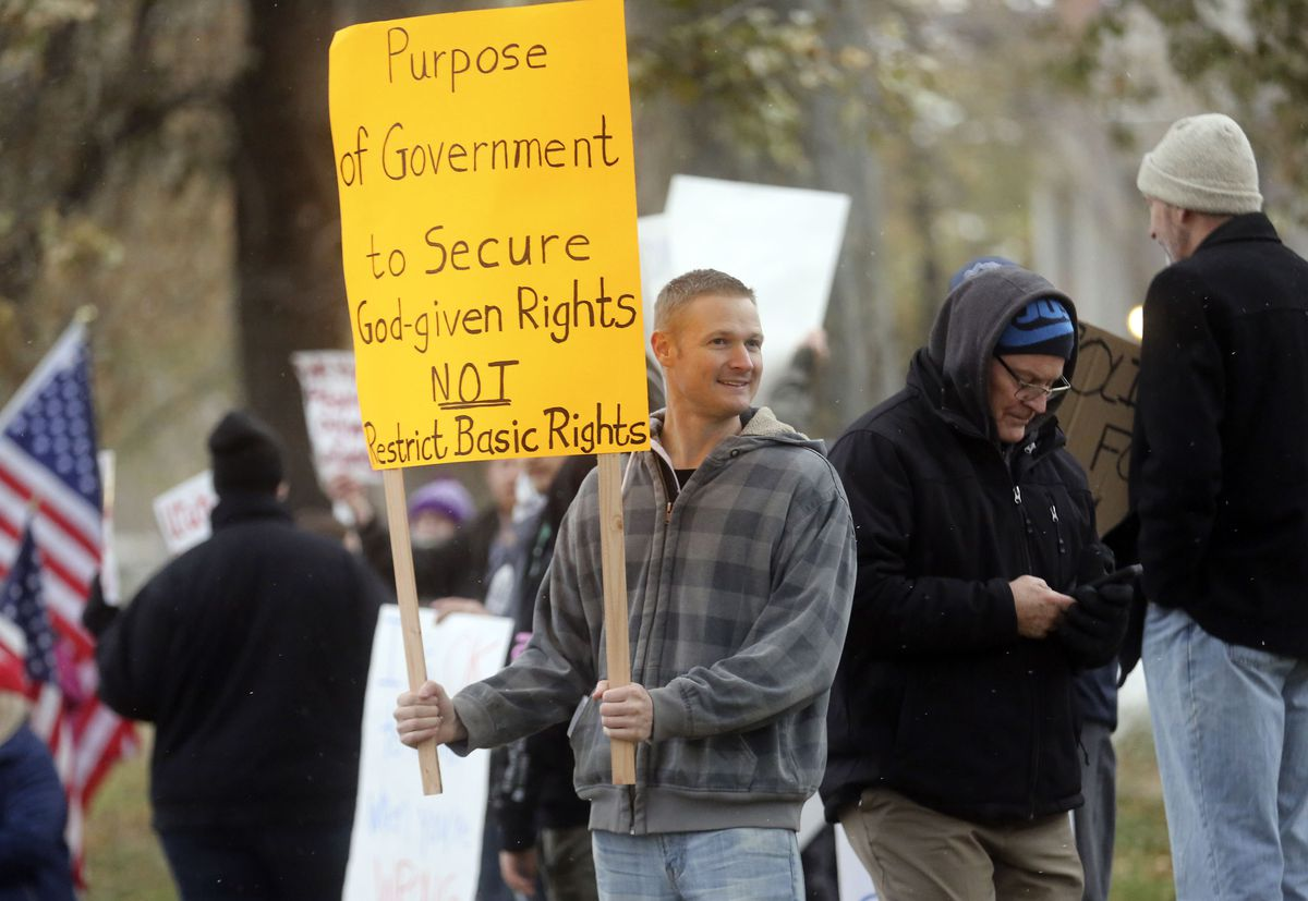 Andrew Pulsipher protests Gov. Gary Herbert's mask mandate and new COVID-19 restrictions outside of the Governor's Mansion in Salt Lake City on Monday, Nov. 9, 2020.