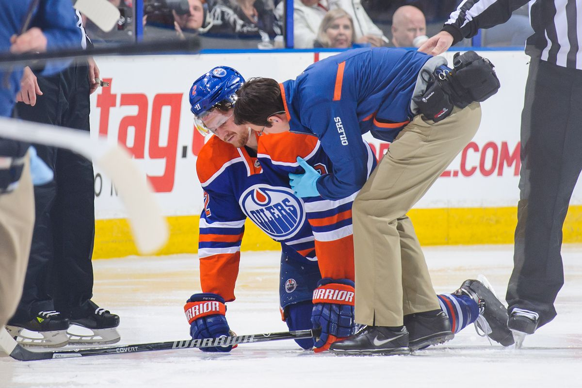 Jeff Petry gets helped off the ice after hitting his head into the boards