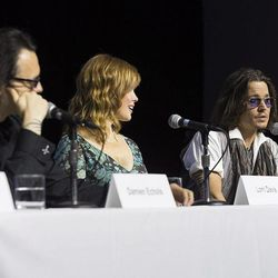 """Actor Johnny Depp, right, speaks at the press conference for documentary """"West of Memphis"""" at the 2012 Toronto International Film Festival in Toronto on Saturday, Sept. 8, 2012."""