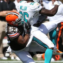 Sep 8, 2013; Cleveland, OH, USA; Cleveland Browns linebacker Craig Robertson (53) tackles Miami Dolphins running back Lamar Miller (26) during the second quarter at FirstEnergy Field.