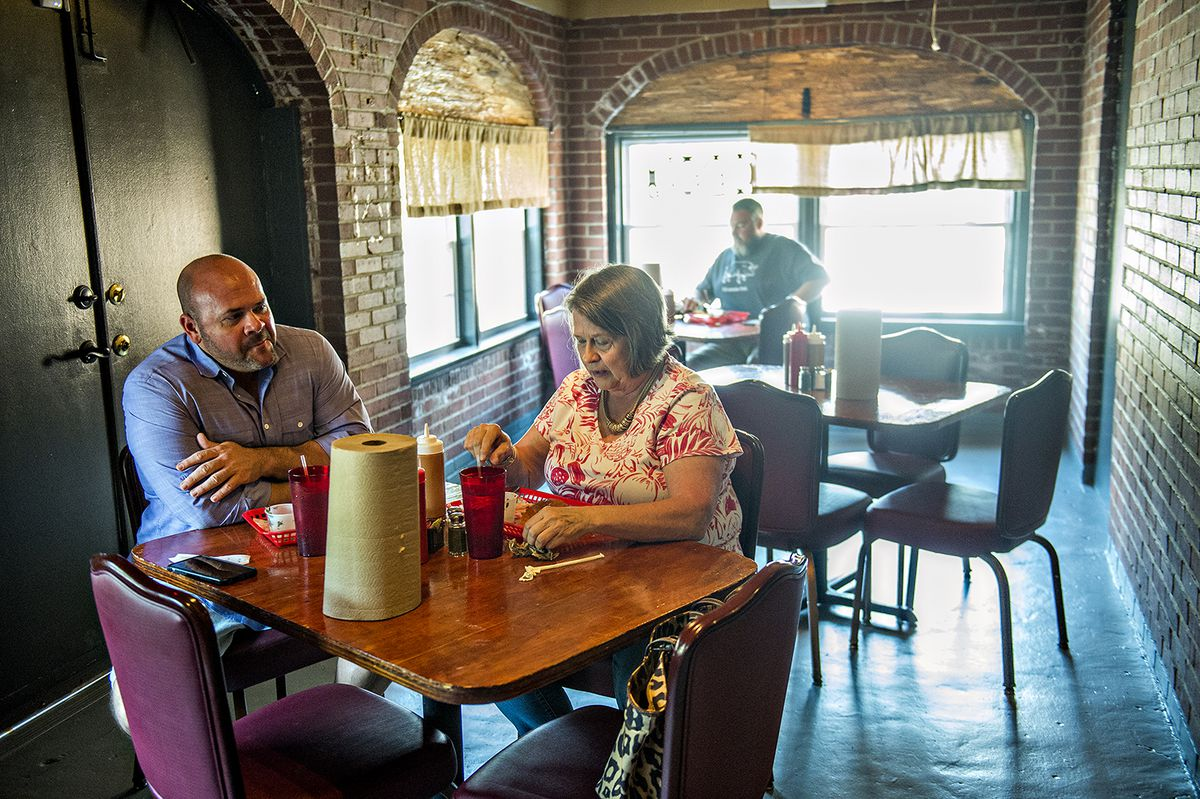 Grabbing a first taste during B's Cracklin' Barbeque's soft opening.