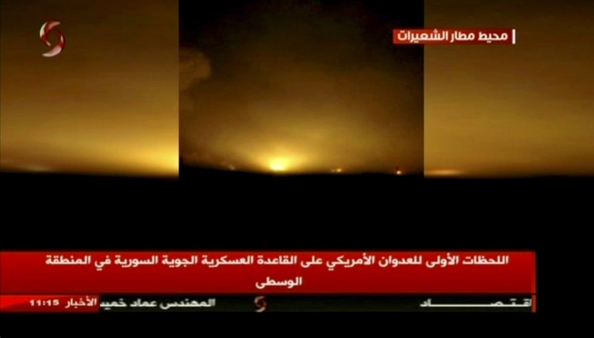 This frame grab from video provided by Ikhbaria TV, a Syrian pro-government TV channel that is consistent with independent AP reporting, shows flames rising from U.S. Tomahawk missiles which hit the Shayrat air base, southeast of Homs, Syria, early Friday