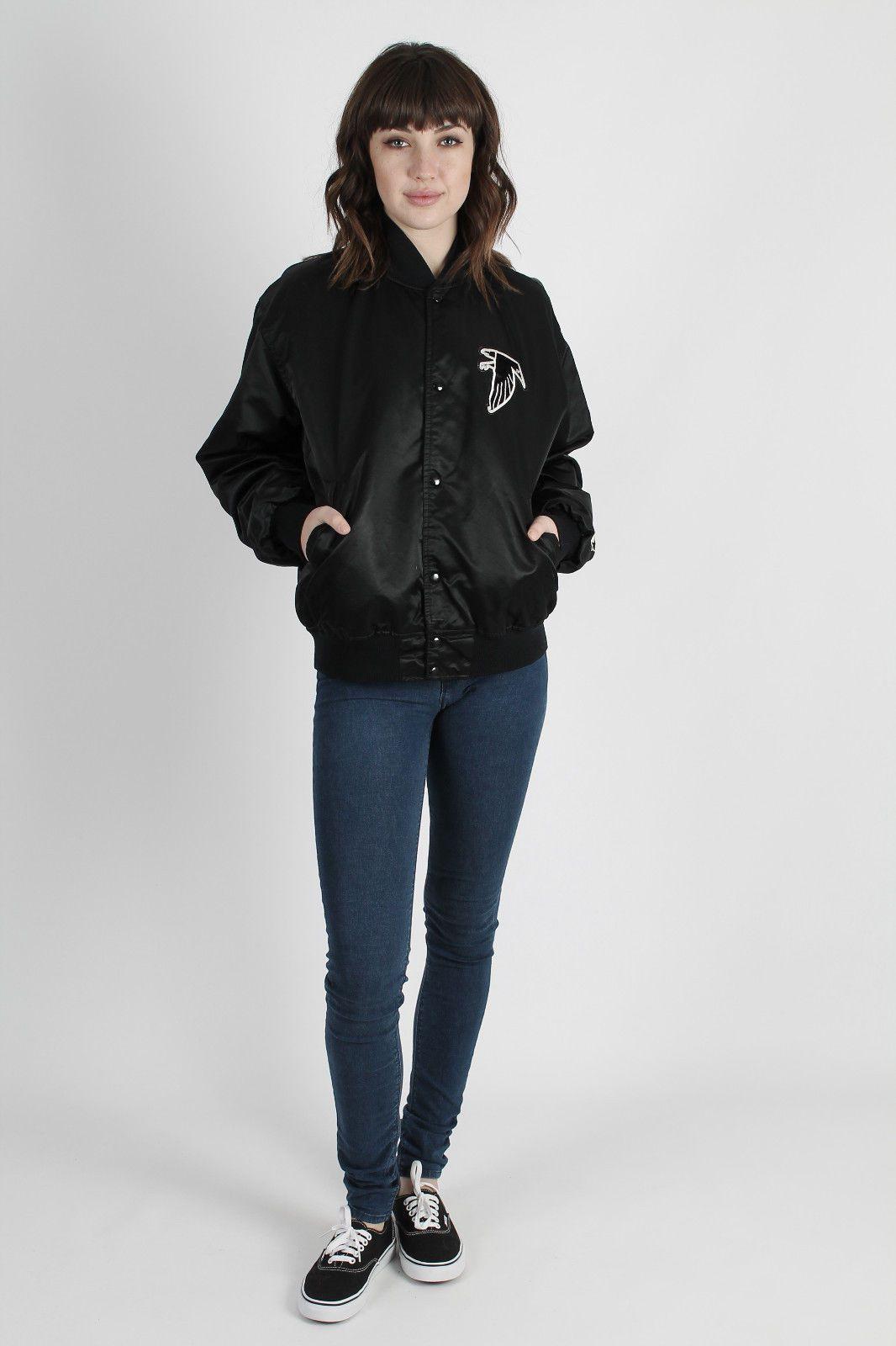 a woman models a vintage Atlanta Falcons jacket