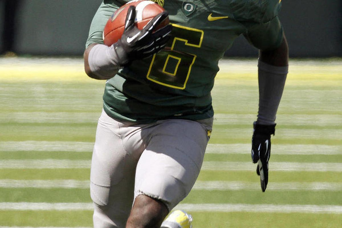 Oregon running back De'Anthony Thomas rushes during the first half of their NCAA college football game against Tennessee Tech in Eugene, Ore., Saturday, Sept. 15, 2012. Oregon won 63-14.