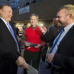 Jim Dabakis and his partner, Stephen Justesen, are married by Salt Lake City Mayor, Ralph Becker as hundreds turn out to obtain marriage licenses Friday, Dec. 20, 2013, in the Salt Lake County offices after a federal judge ruled that Amendment 3, Utah's same-sex marriage ban, is unconstitutional.