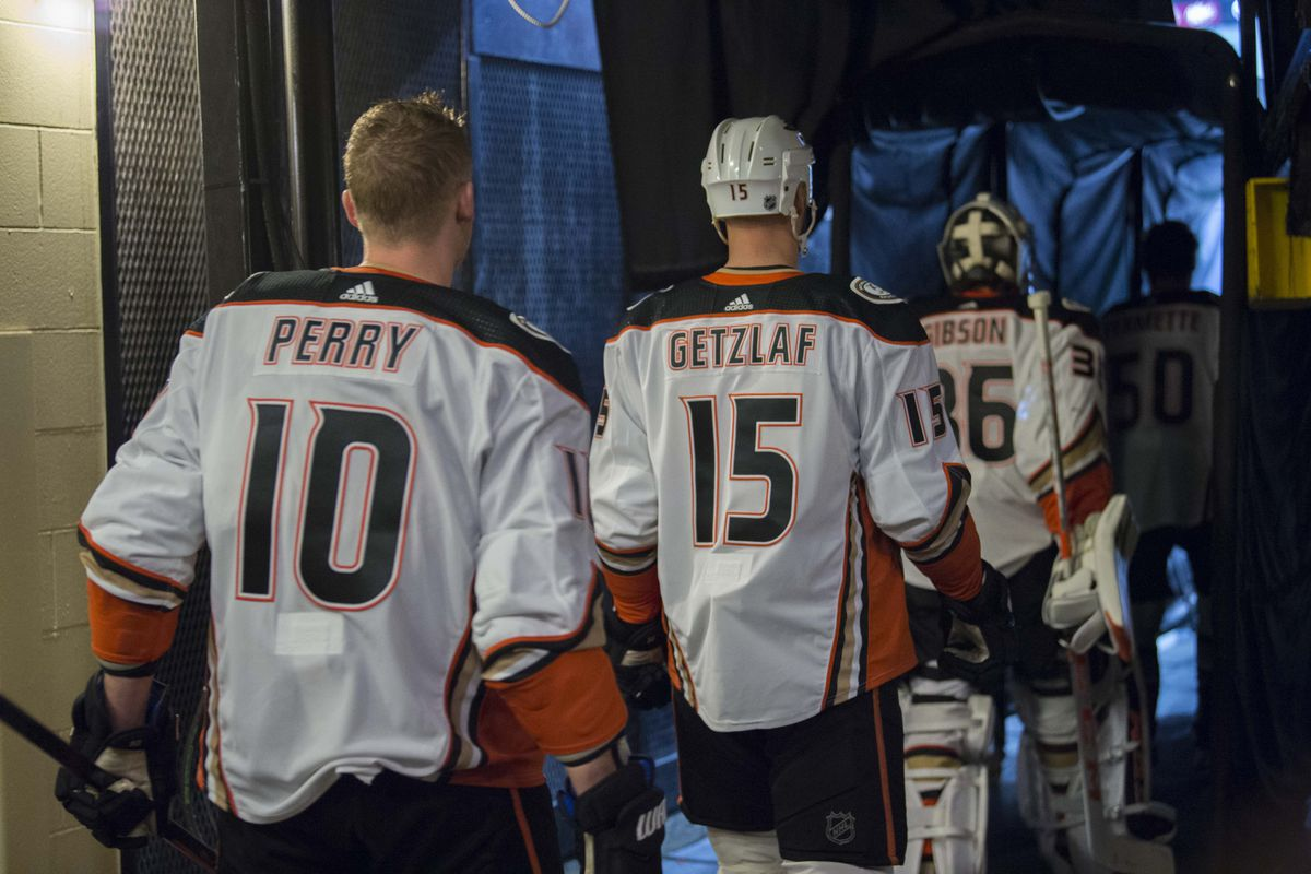 Mar 9, 2018; Dallas, TX, USA; Anaheim Ducks right wing Corey Perry (10) and center Ryan Getzlaf (15) and goalie John Gibson (36) take the ice to face the Dallas Stars at the American Airlines Center.