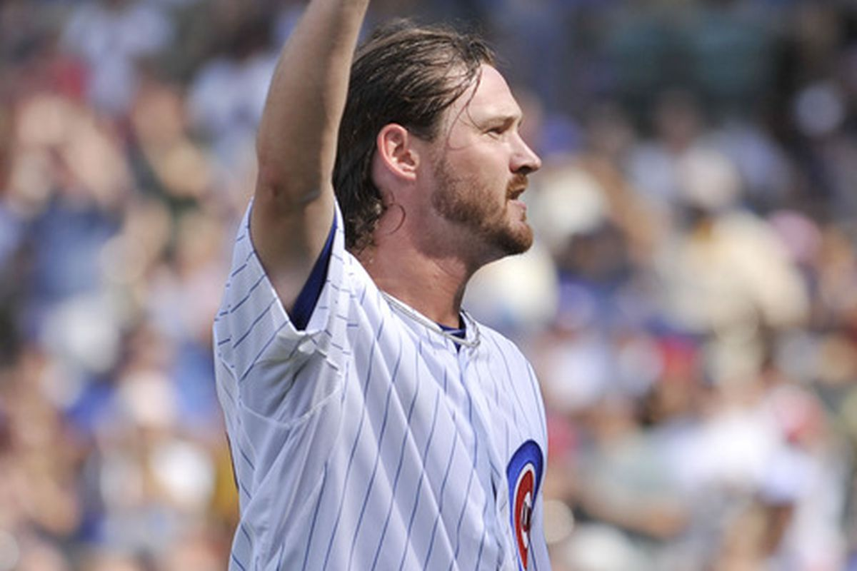 Starting pitcher Travis Wood of the Chicago Cubs tips his hat to the crowd as he is taken out of the game against the Houston Astros at Wrigley Field in Chicago, Illinois.  (Photo by Brian Kersey/Getty Images)