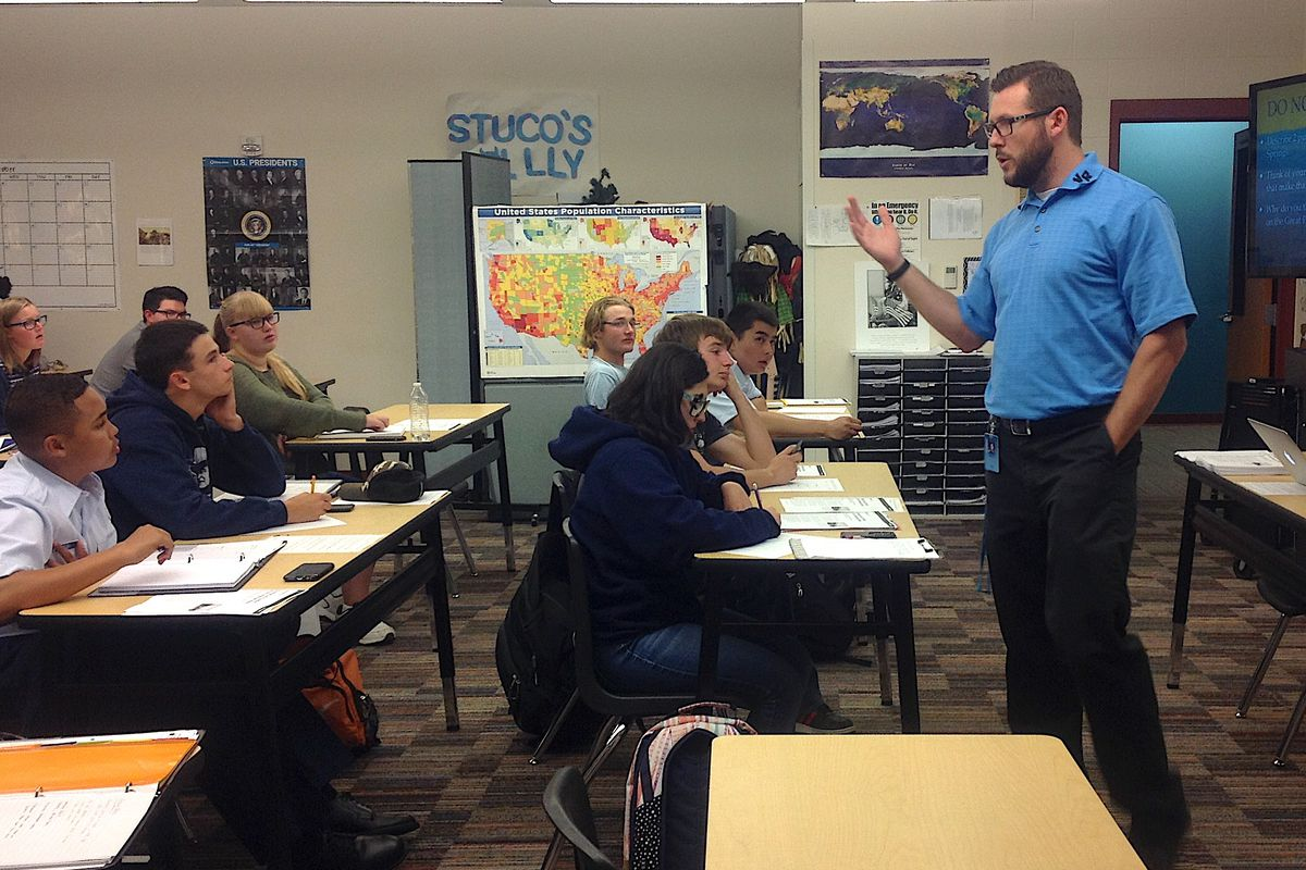Nathan Pearsall, a history teacher at Vista Ridge High School, with his students.