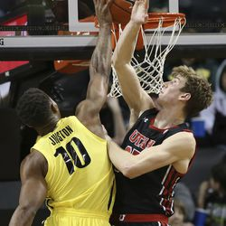 Oregon's Shakur Juiston, left, shoots next to Utah's Branden Carlson during the second half of an NCAA college basketball game in Eugene, Ore., Sunday, Feb. 16, 2020.