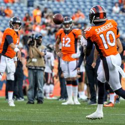 Broncos QB Case Keenum (4) watches as his pass is about to connect with WR Emmanuel Sanders.