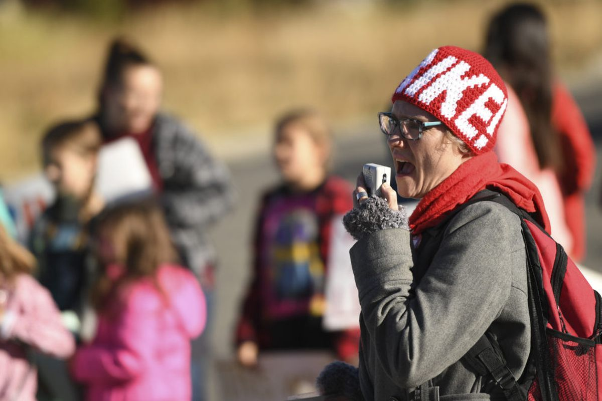 Kiersten Macreery, a third grade teacher for Park County School District, leads a chant on the first day of a teacher strike in Fairplay.