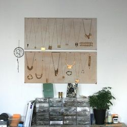 """""""I use the sample wall to store and display production samples. It doesn't hold every piece I've designed, mostly just the ones that are being produced. It's also helpful to have as a reference point. When I'm designing new pieces, I can look up and see h"""