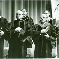 Elder Boyd K. Packer (from left), Elder Marion G. Romney,Bishop Robert L. Simpson, President Harold B. Lee, Elder Paul H. Dunn and Dr. Henry B. Eyring observe the flag ceremony at Dr. Eyring's inaugural at Ricks College.