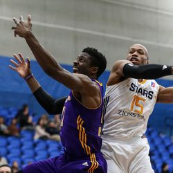 Los Angeles D-Fenders guard David Nwaba (11) lays it up in front of Salt Lake City Stars guard Sundiata Gaines (15) at the Lifetime Activities Center in Taylorsville on Wednesday, Feb. 08, 2017.