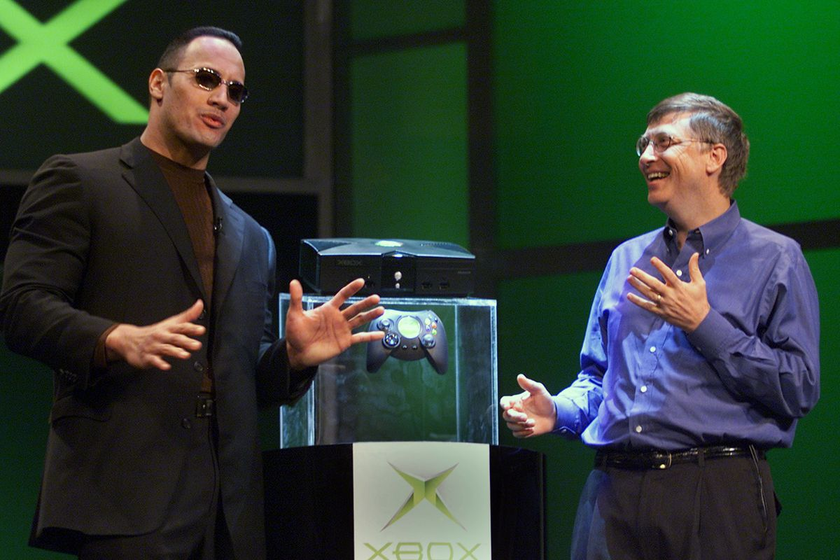 """The Rock and Bill Gates w/ Original Xbox (""""Jeff Christensen / AFP / Getty Images"""")"""