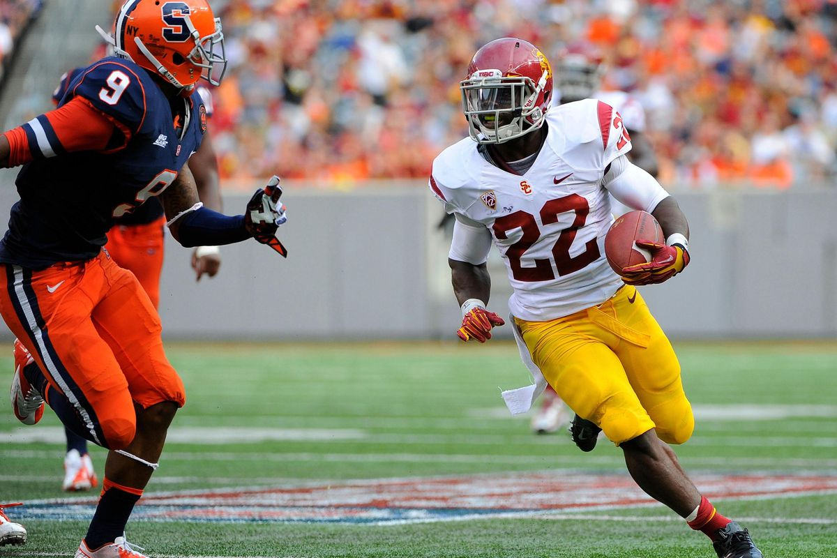 Sep 8, 2012; East Rutherford, NJ, USA; USC Trojans running back Curtis McNeal (22) runs with the ball past Syracuse Orange cornerback Ri'Shard Anderson (9) during the second quarter at MetLife Stadium.  Mandatory Credit: Rich Barnes-US PRESSWIRE