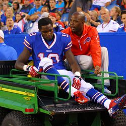 Aug 16, 2013; Orchard Park, NY, USA;  Buffalo Bills wide receiver Kevin Elliott (18) gets taken off the field with a injury during the first half against the Minnesota Vikings at Ralph Wilson Stadium.