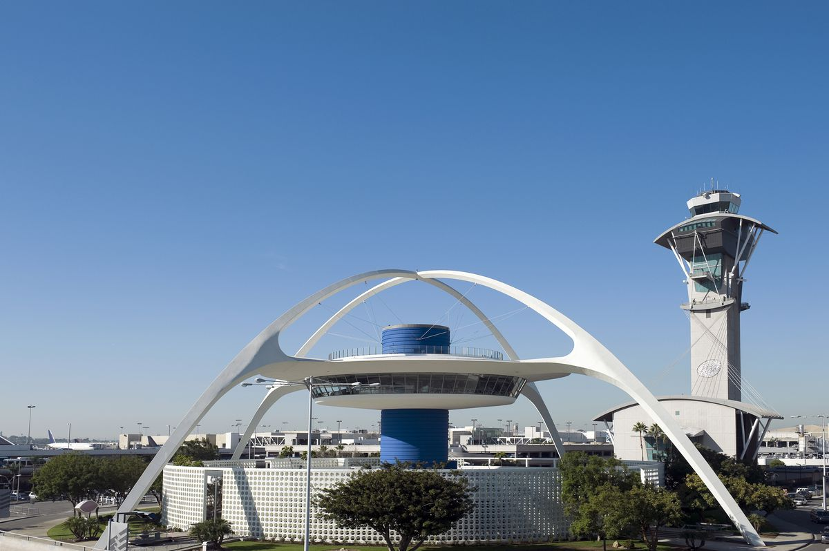 Two white arches hover over an elevated round hub centered on a blue cylinder.
