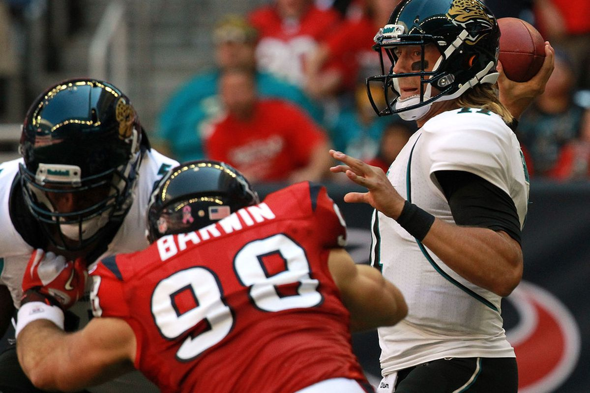 HOUSTON, TX - OCTOBER 30:   Blaine Gabbert #11 of the Jacksonville Jaguars throws against the Houston Texans at Reliant Stadium on October 30, 2011 in Houston, Texas.  (Photo by Ronald Martinez/Getty Images)