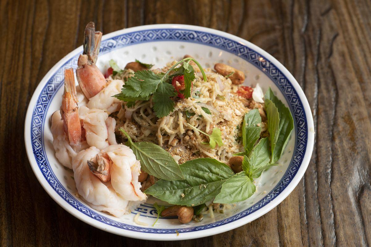 bowl of thai noodles, basil, and shrimp