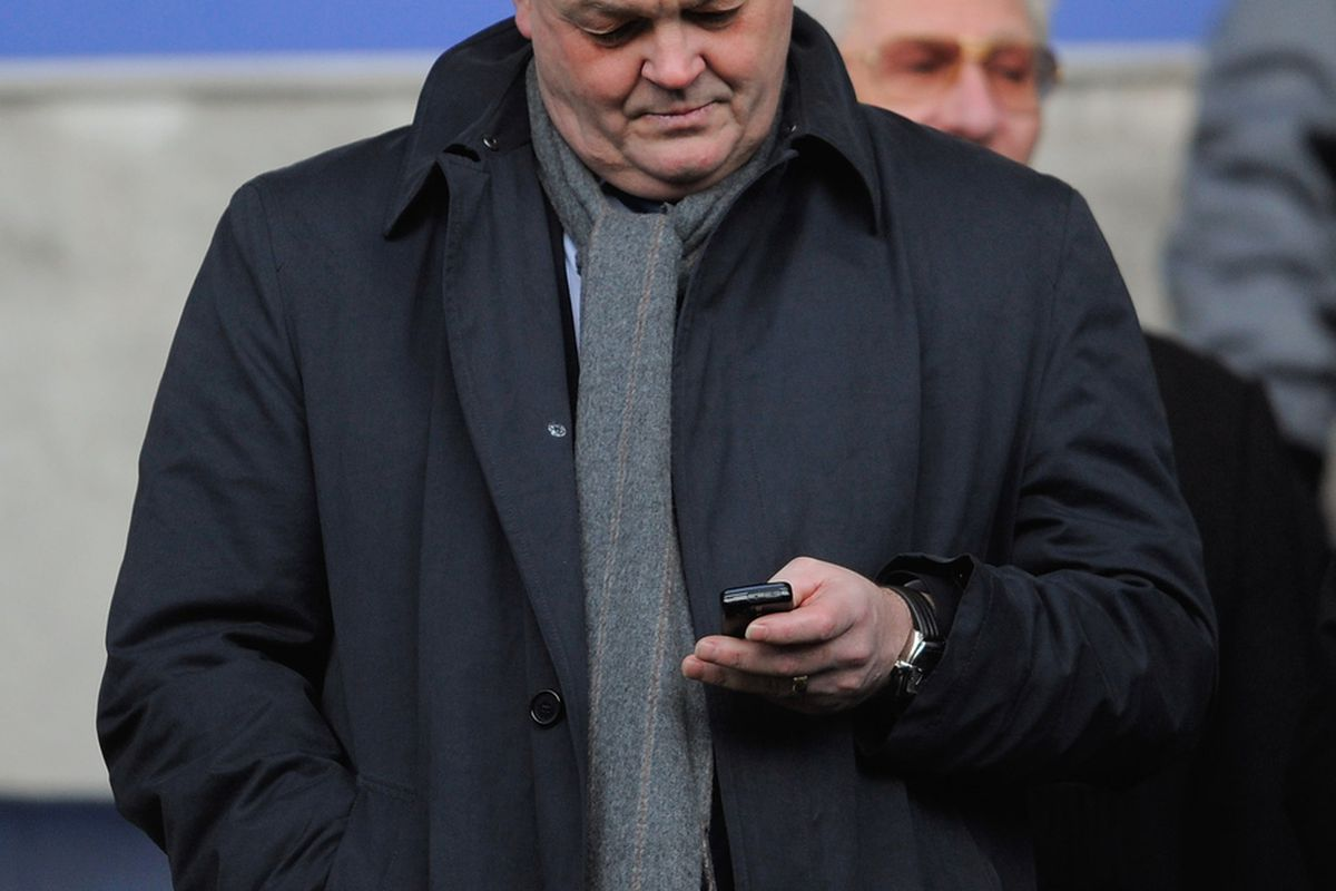 BOLTON, ENGLAND - JANUARY 02: Bolton Chairman Phil Gartside checks his phone before the FA Cup 3rd Round match between Bolton Wanderers v Lincoln City at the Reebok Stadium on January 2, 2010 in Bolton, England. (Photo by Michael Regan/Getty Images)